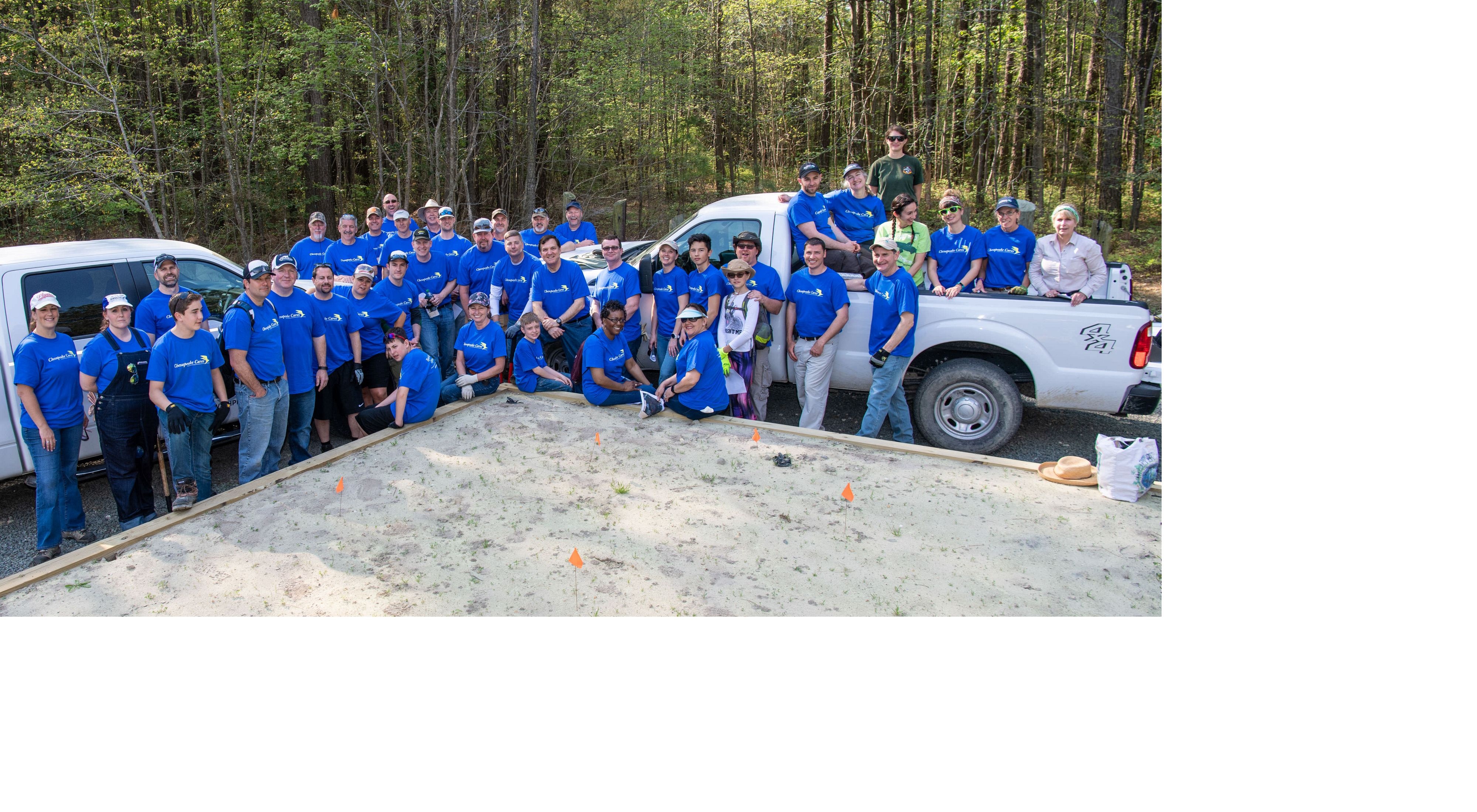 Group Photo from a volunteer day at Ponders Tract with Chesapeake Utilities.