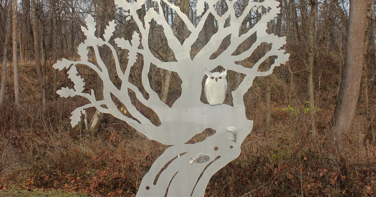 a metal sculpture of a tree
