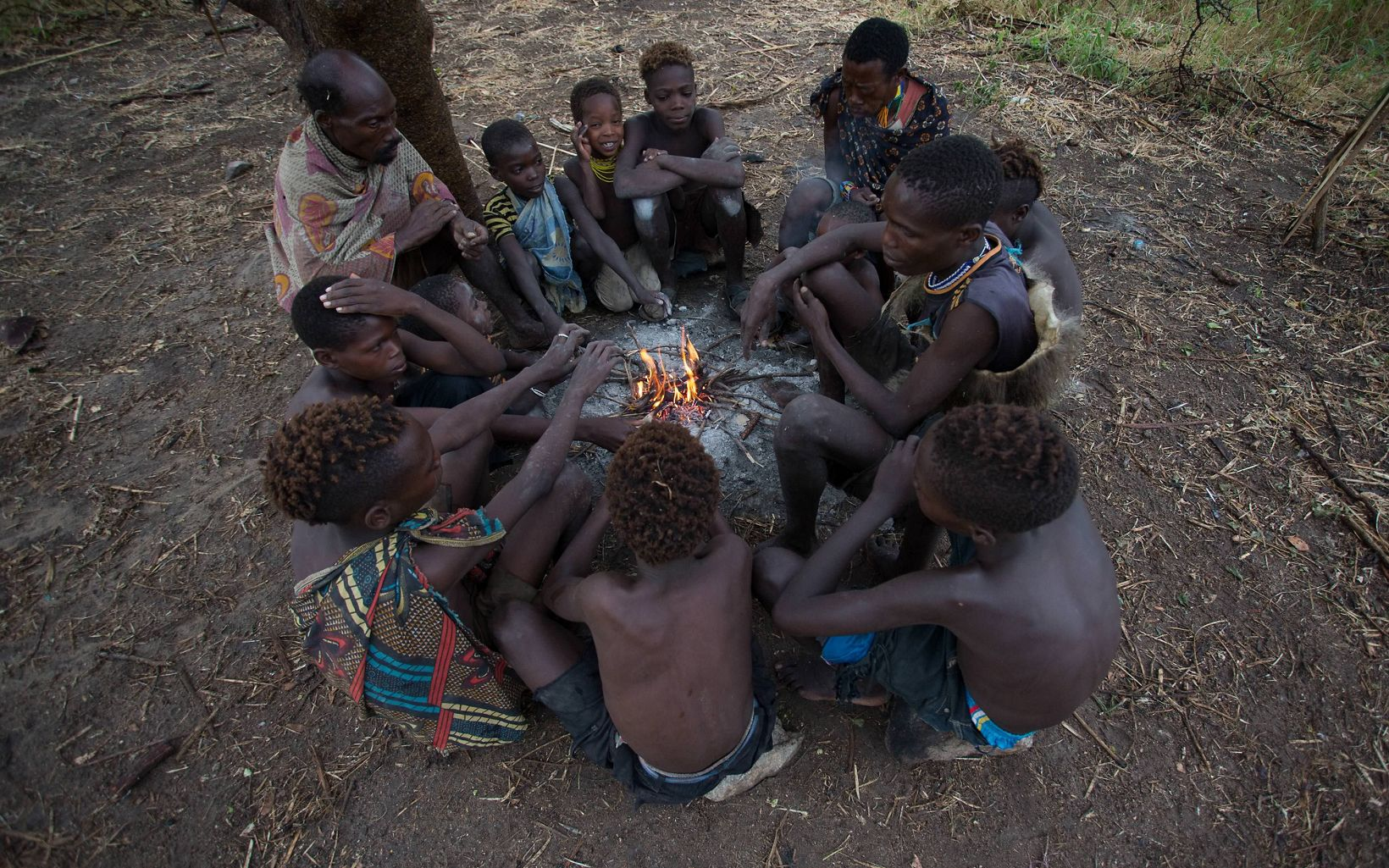 At sundown, members of the Hadza tribe come together to build a fire and share stories from the day.