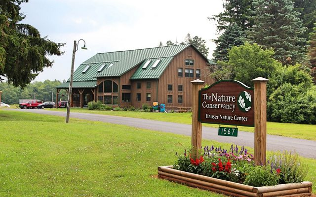 A wood building serves as a nature center and local preserve.
