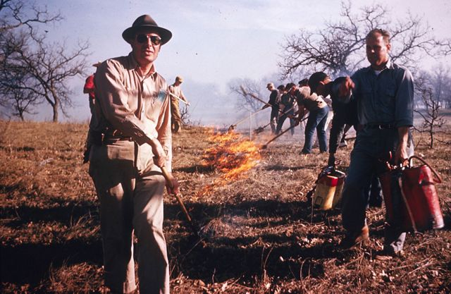 In this 1962 photo, Nature Conservancy workers start the organization's first controlled burn on a preserve in Minnesota.