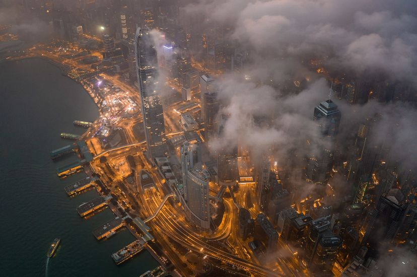 The view of the world famous Victoria Harbour under the clouds in the early morning.