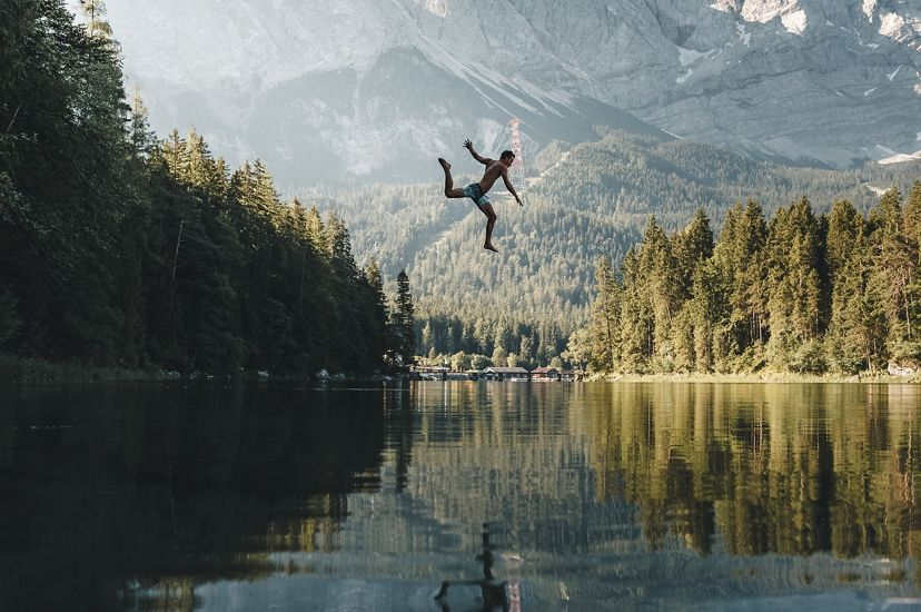 A jump into the iconic lake Eibsee in southern Germany on a hot summer day.