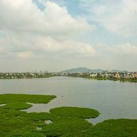 A view of the lake Sembakkam in Chennai, showcasing its vast expanse and development all around.