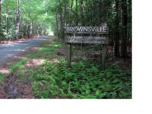 Preserve sign next to the paved road leading into Brownsville Preserve.