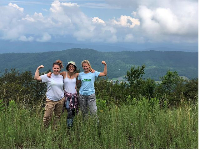 Interns in the Leaders in Environmental Action for the Future program flex their muscles on Warm Springs Mountain.