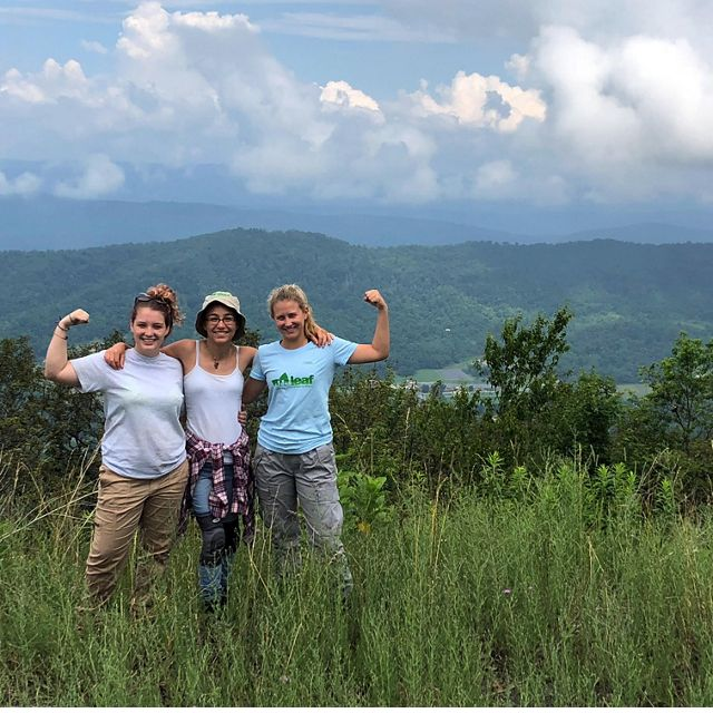Three girls stand together on Warm Springs Mountain.