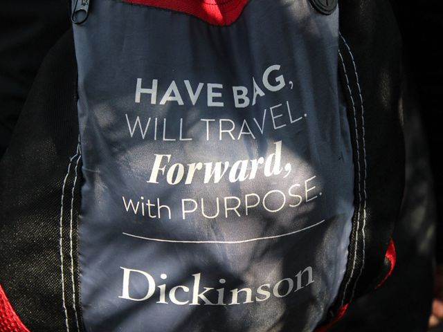 "Backpack with inspirational message written on it: ""Have bag, will travel forward, with purpose. Dickinson."""