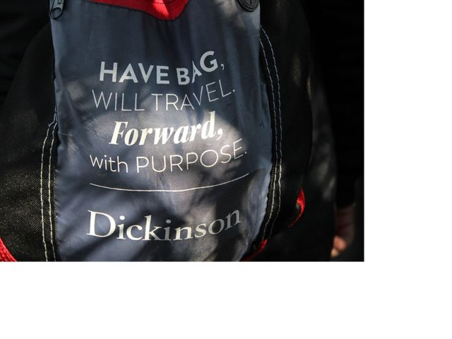 """Backpack with inspirational message written on it: """"Have bag, will travel forward, with purpose. Dickinson."""""""