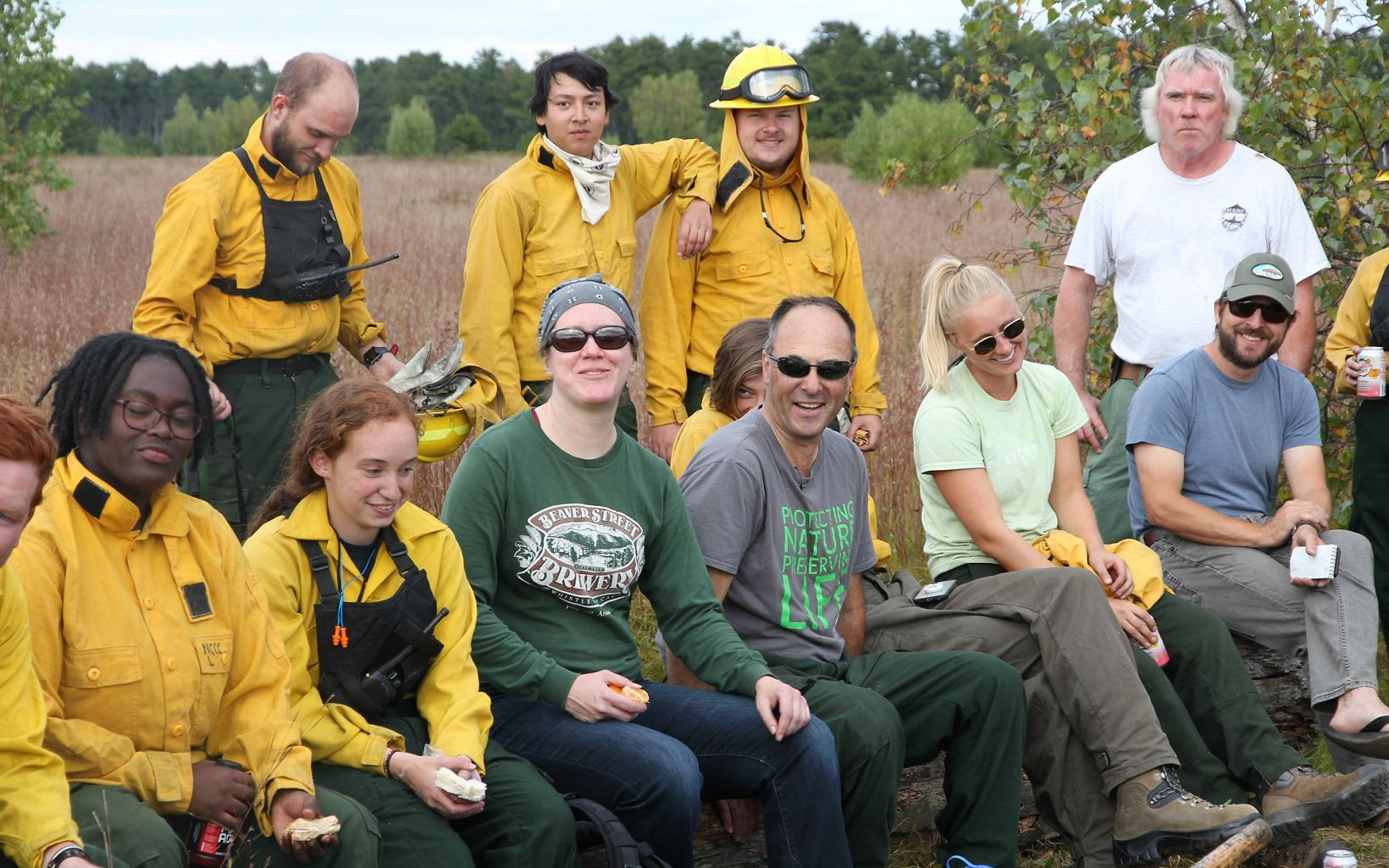 Prescribed fire crew team members relaxing after a controlled burn at Kennebunk Plains Preserve.
