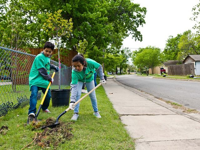 Children take part in a tree planting in Dallas, Texas.