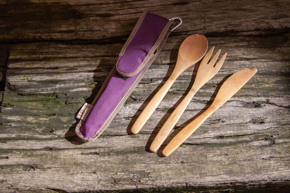 A wooden spoon, fork and knife and carrying case.