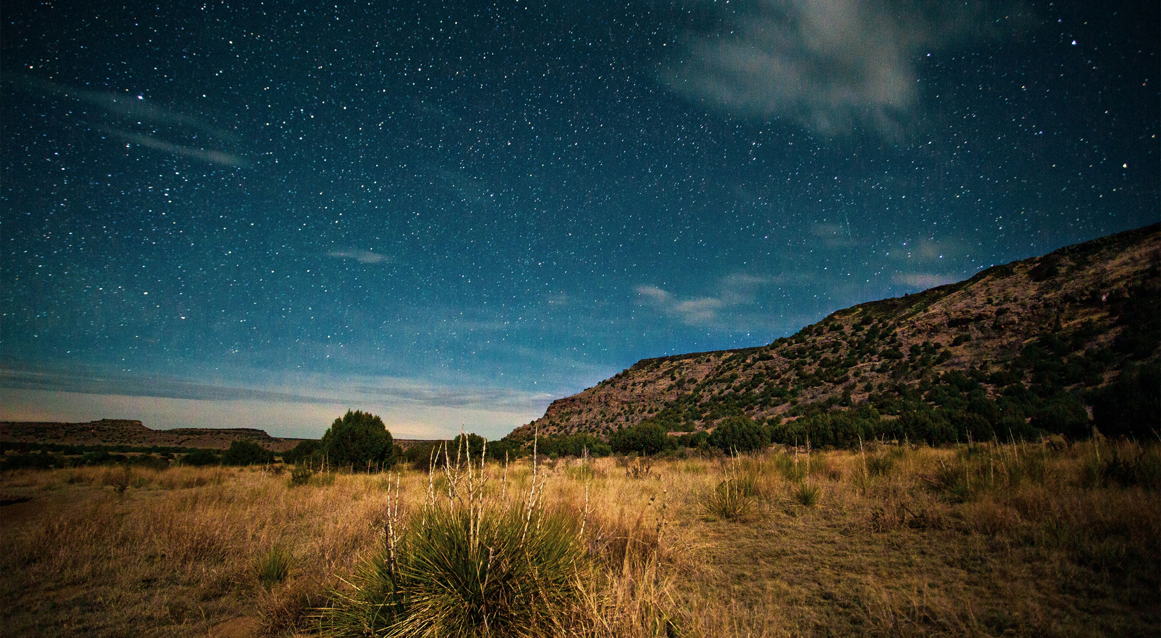 Under the emerging stars as the sunsets at Black Mesa State Park and Nature Preserve.