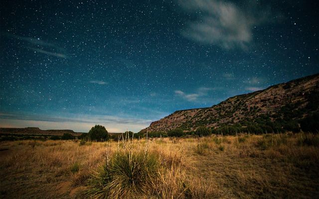 View of the mesa next to the stars at Black Mesa State Park and Nature Preserve.