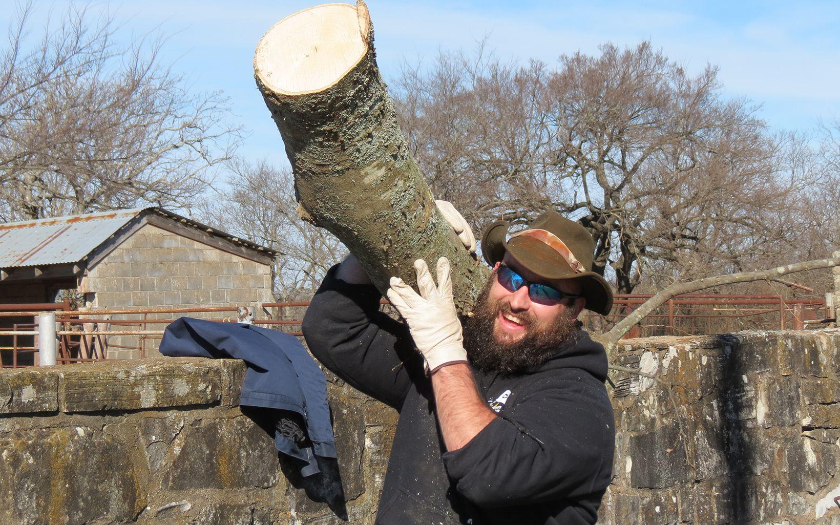 Volunteer removing debris along Blue River