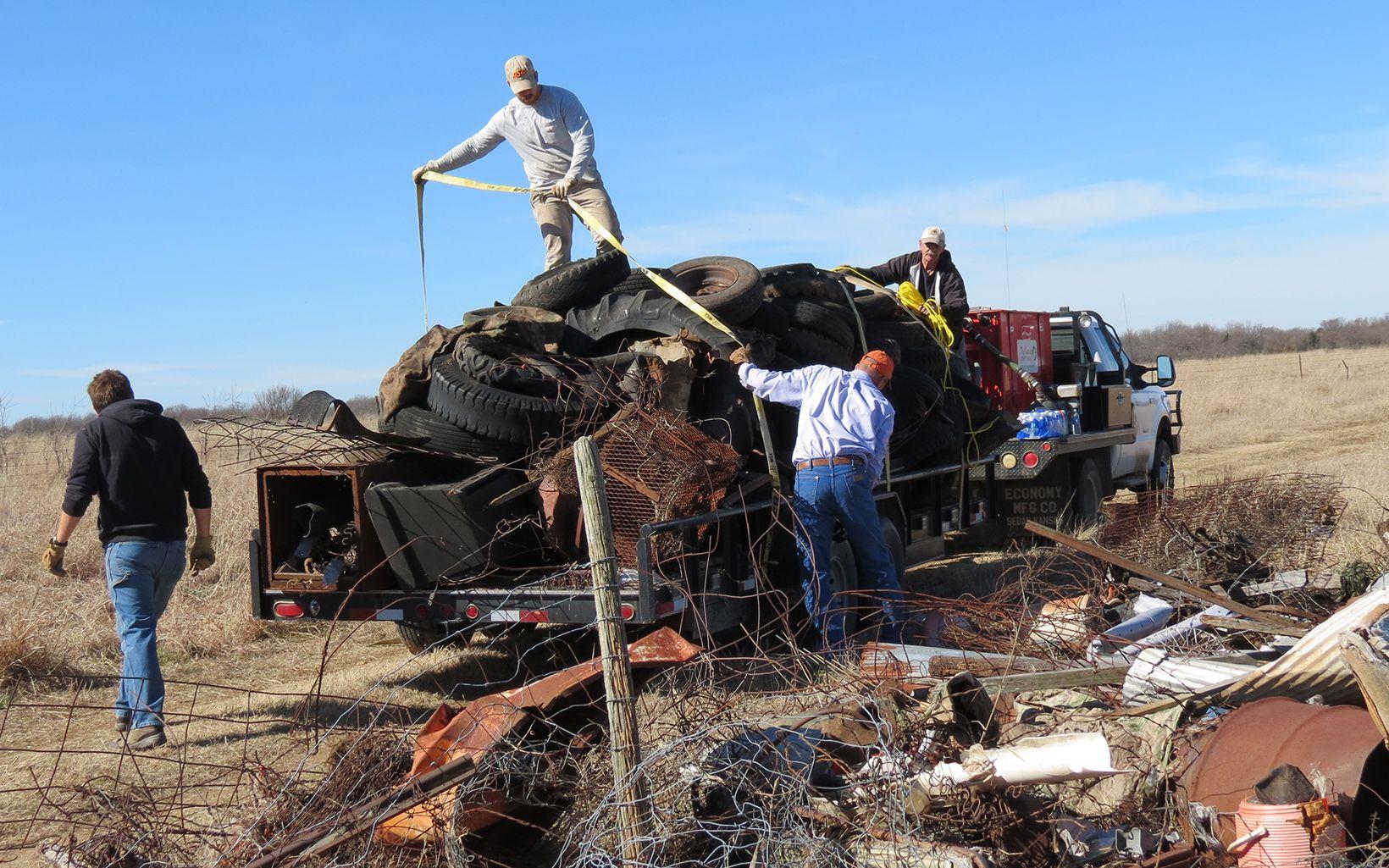 Volunteers loading trash along Blue River