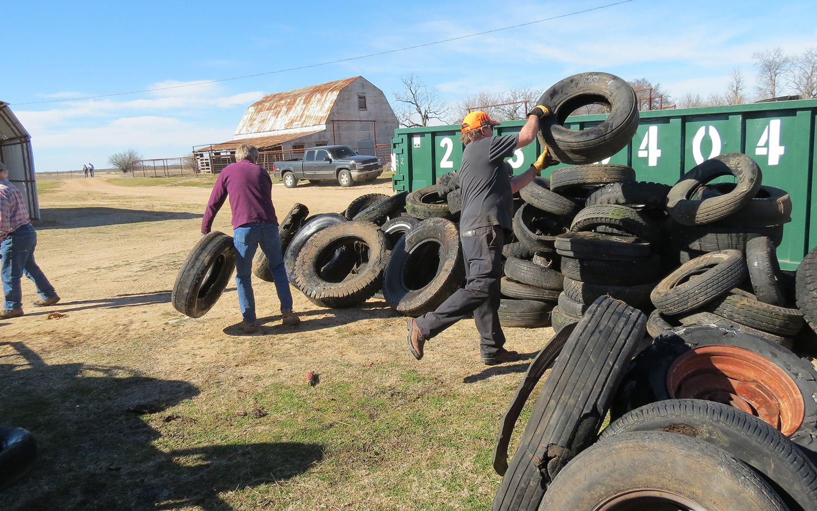 Volunteers gathering tires along Blue River