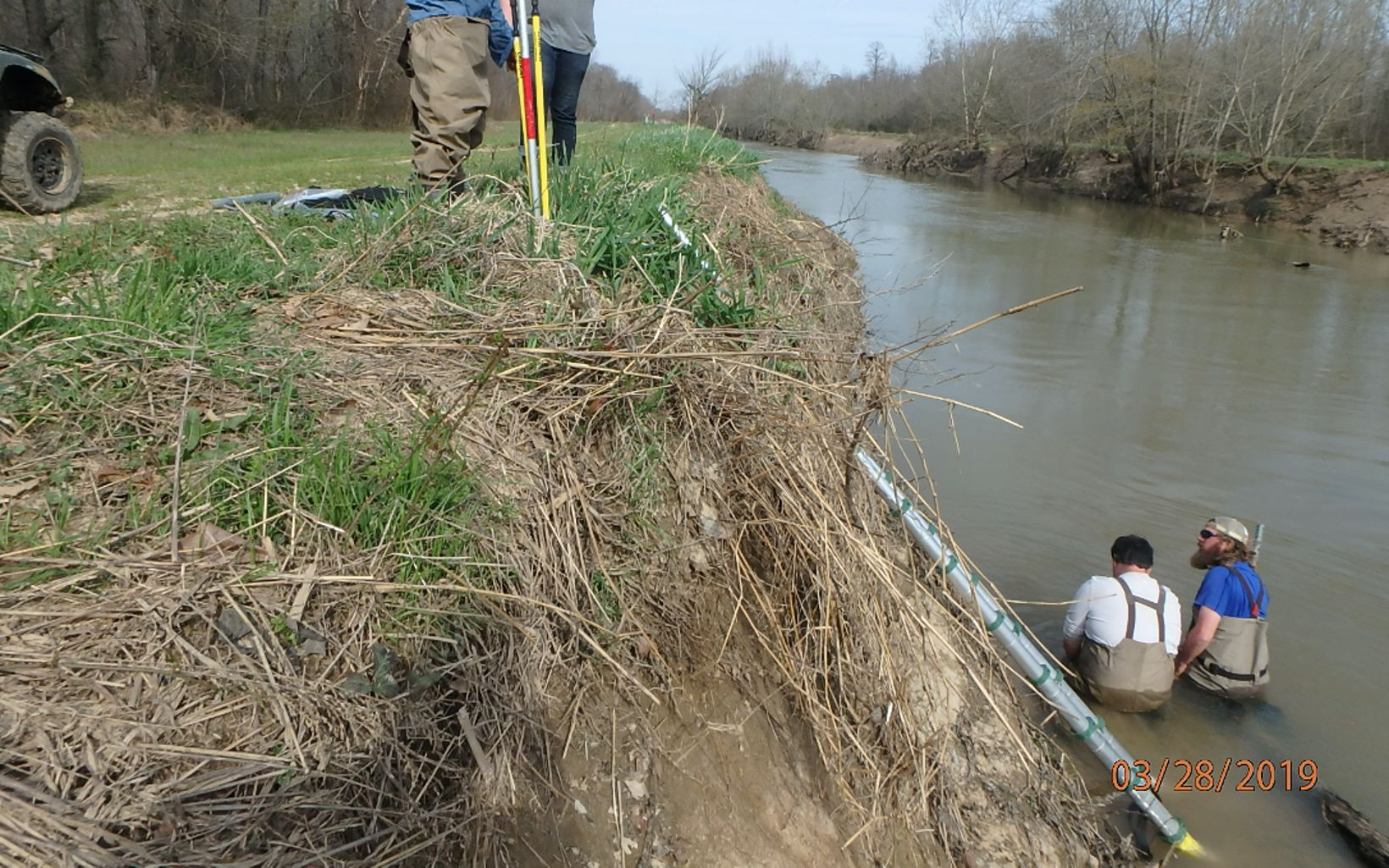 Researchers place water level sensors in a creek.