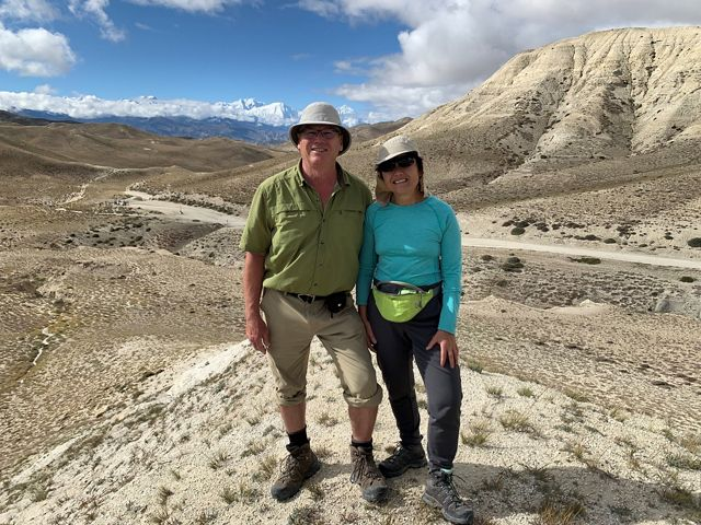 Jon Goulden and Kwok Lau posing for a photo with a desert view.