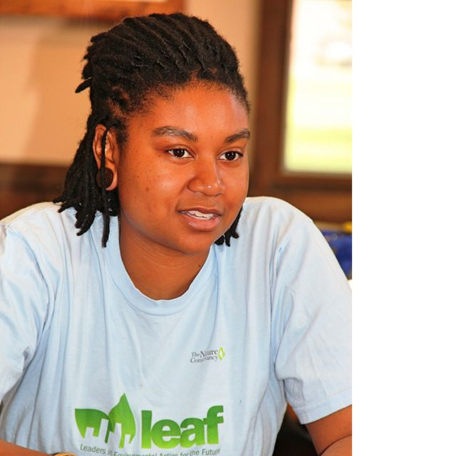 A young lady in a blue LEAF tee-shirt.