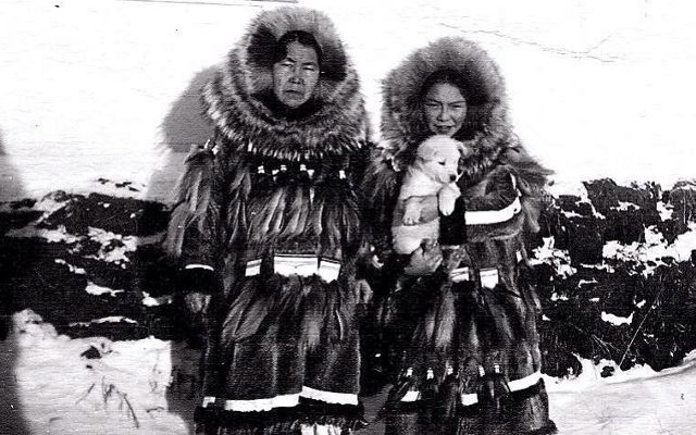A black and white photo of a man and a woman in parkas