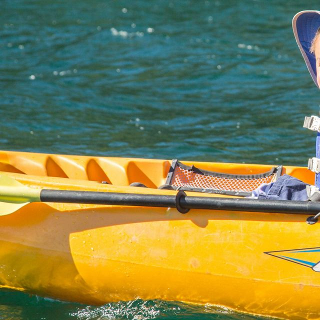 Boy enjoying kayak on Independence Lake in the Sierra Nevada