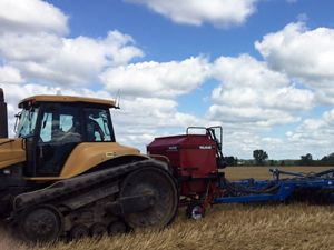 Wisconsin farmer using an air seeder donated by The Nature Conservancy to plant cover crops.