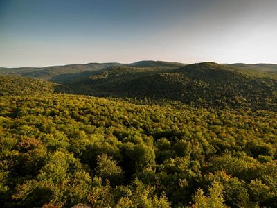View from Kimball Hill across the Groton Highlands toward Newfound Lake in Groton, New Hampshire.
