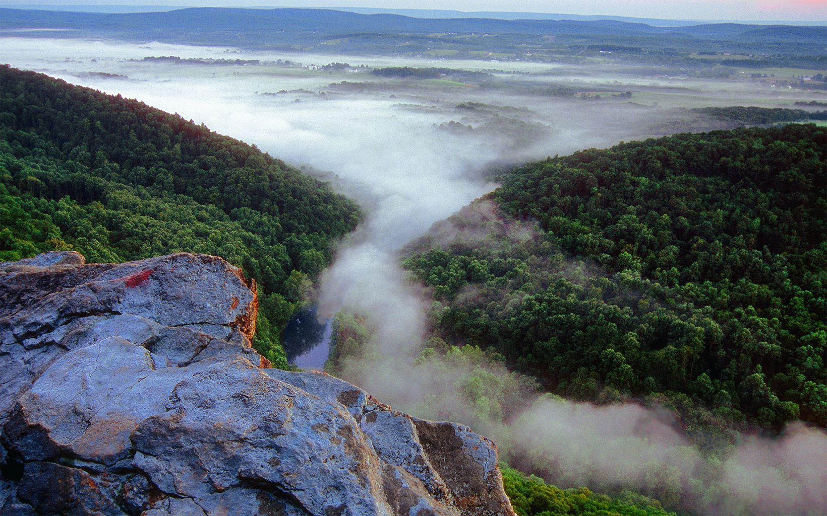 A mist rolls across the Susquehanna River.