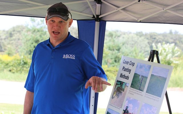Man in blue shirt giving a presentation on soil health