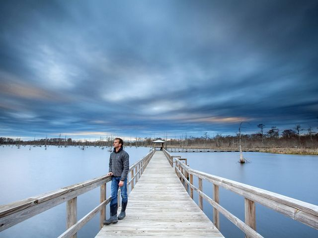 Self portrait of photographer Ian Shive on assignment, Black Bayou Lake, part of the National Wildlife Refuge and Fish and Wildlife Service of the Department of the Interior.