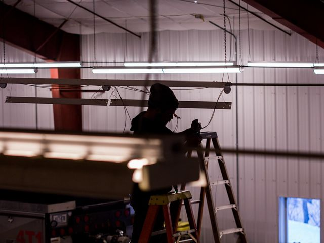 Electrician installs LED fixtures at the Cornish Fire Department.
