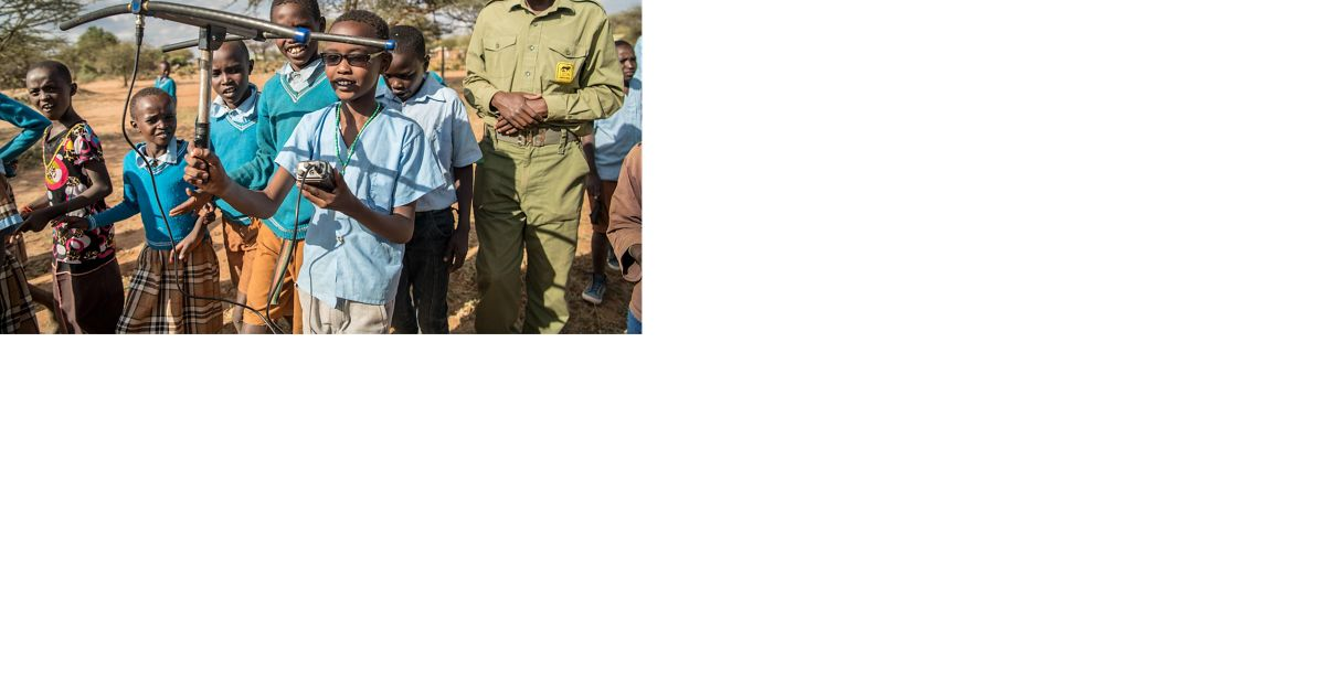 Lion Landscapes' Thomas Mojong teaches Ewaso Primary school students about lions.