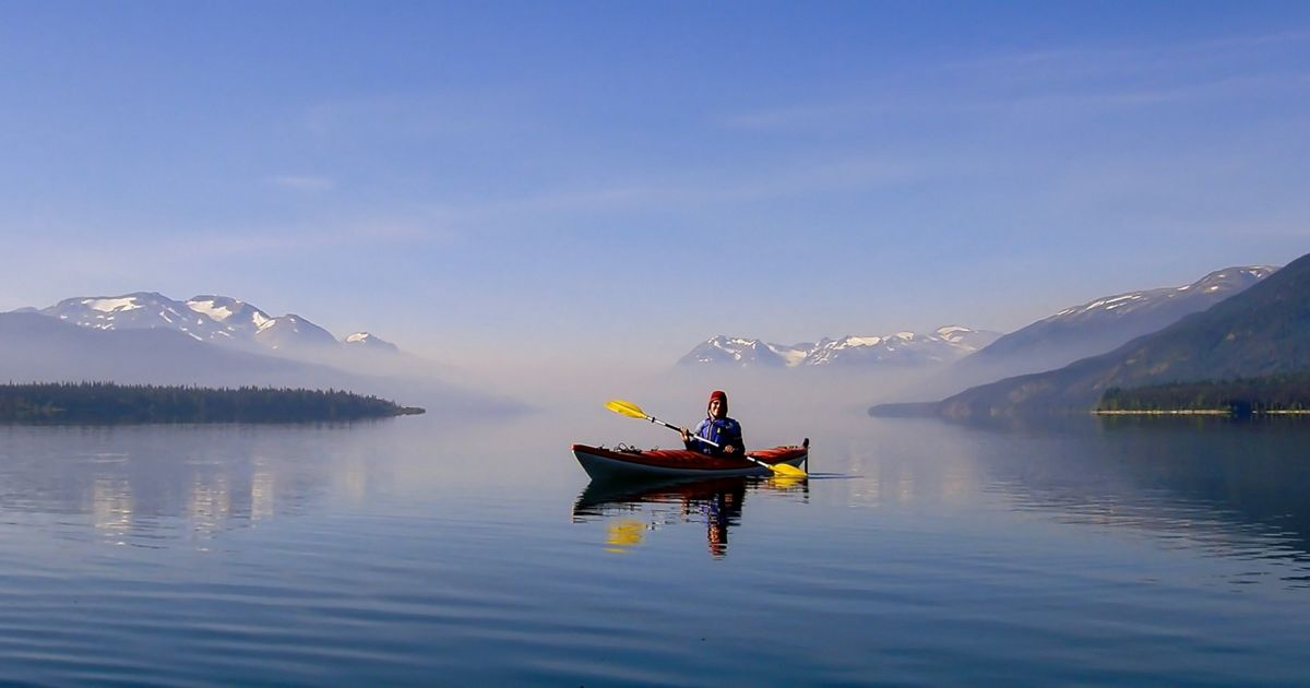 Kayaker at Morice Lake, British Columbia, Canada, with smoke from a forest fire. This photo was entered into The Nature Conservancy's 2018 Photo Contest.