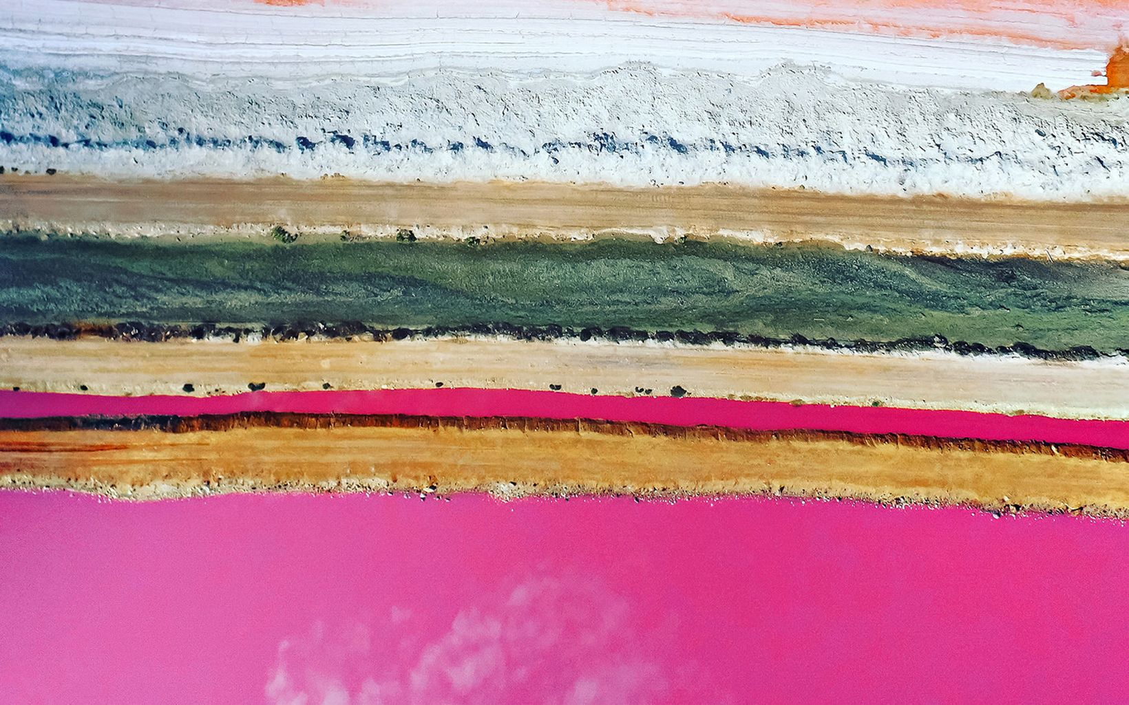 Drone photo showing the pink hues of a pink lake called Hutt Lagoon, Western Australia.