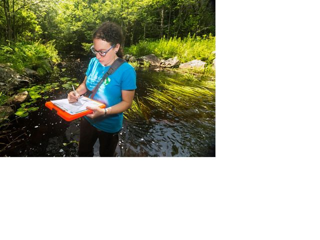 The Nature Conservancy in Massachusetts' Laura Marx records culvert survey data in Becket, Massachusetts.