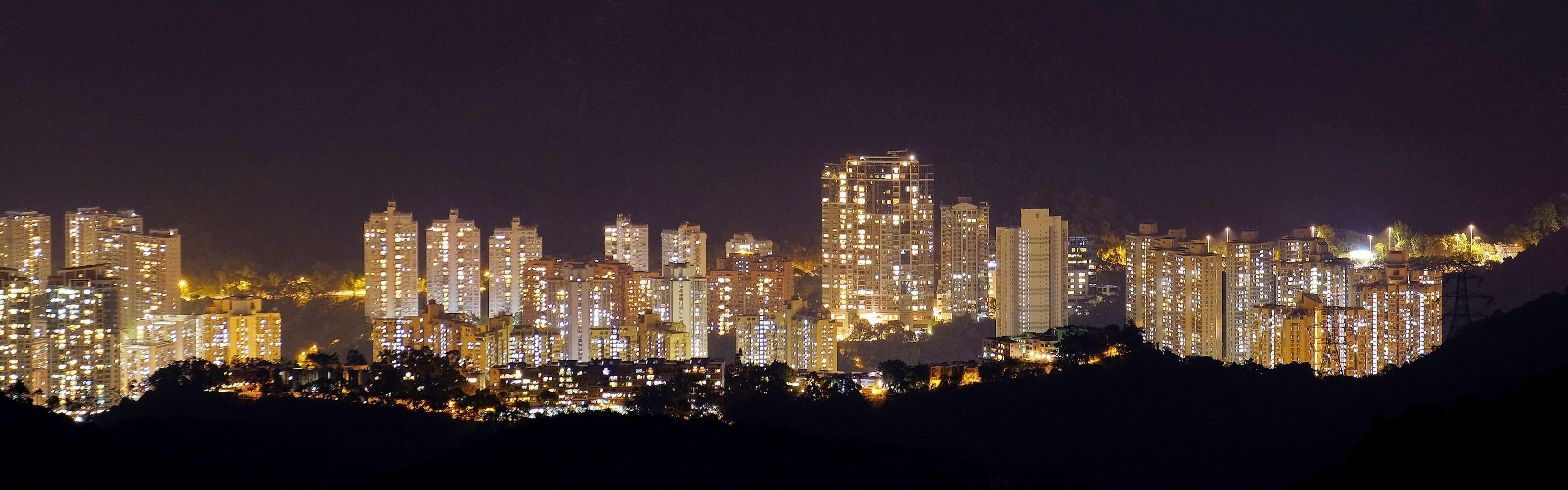 surrounded by the expanse of urban Hong Kong. Image taken in Tai Mo Shan.