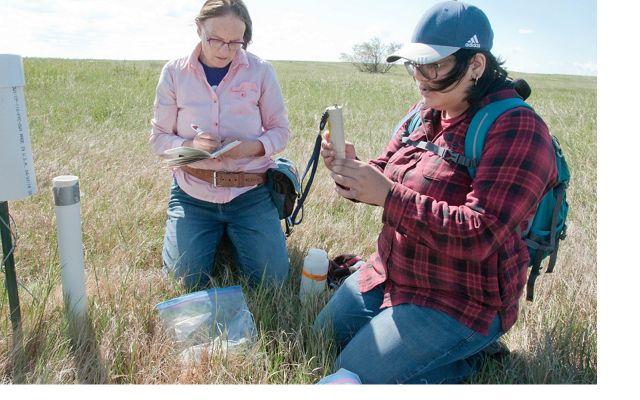 Lisa Lamb and Alicia Gaytan record water chemistry data.