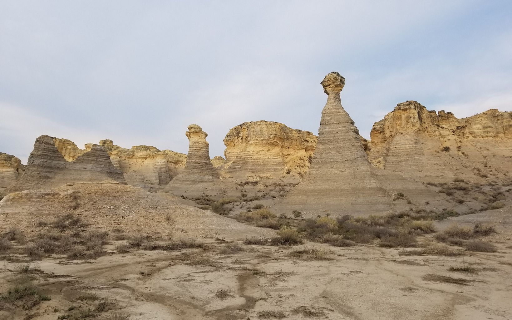 A ground-level view of rock formations at Little Jerusalem Badlands State Park in Kansas.