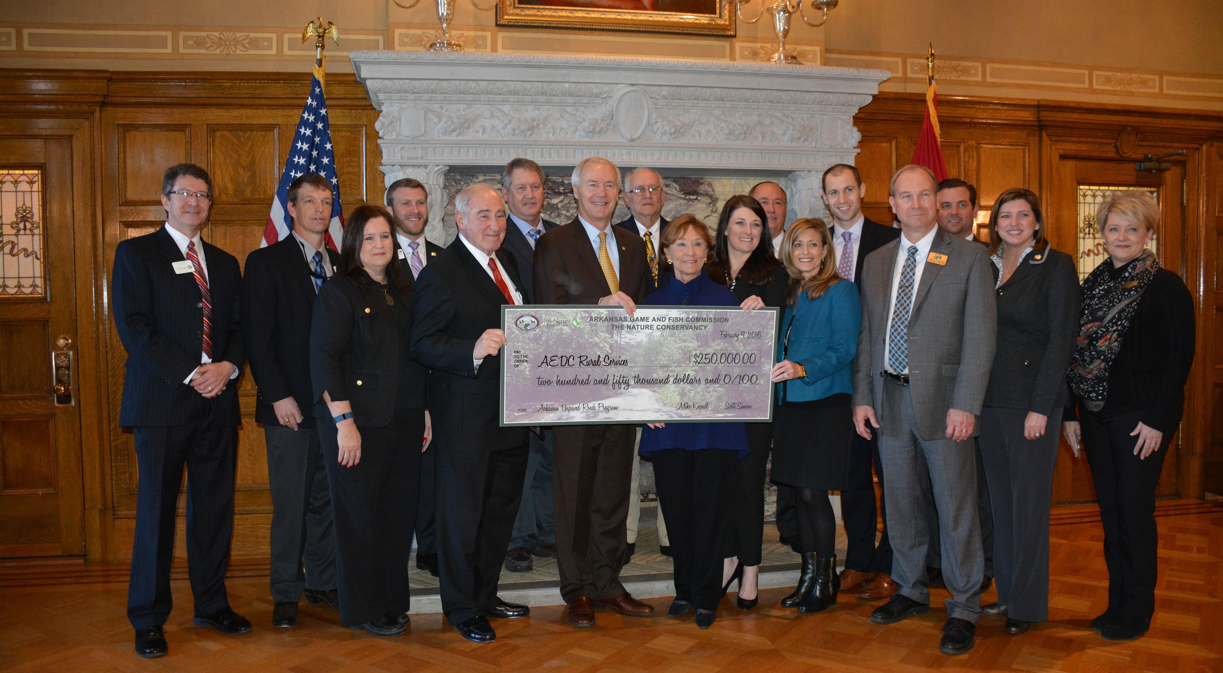 The Arkansas Game and Fish Commission and The Nature Conservancy present Governor Asa Hutchinson and the Department of Rural Services with a check to support the Unpaved Roads Program.