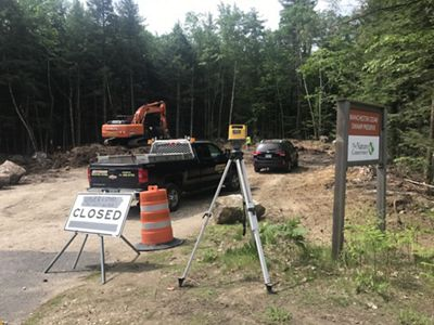 A construction zone by the woods.