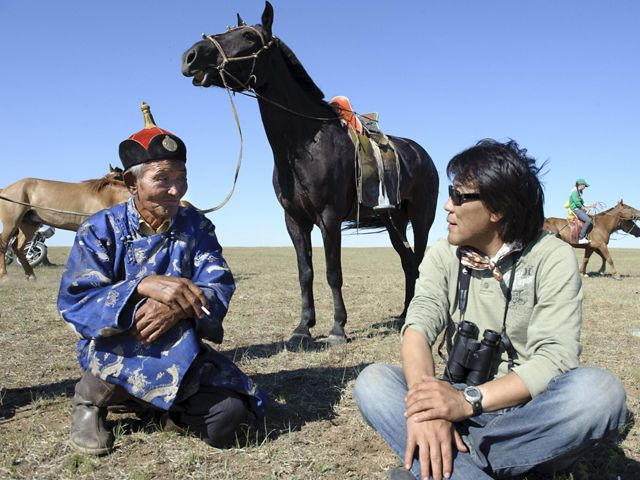 Galbadrakh (Gala) Davaa, (on right - Director of Conservation for the Conservancy's Mongolia Program) talks with a Mongolian elder who is there to oversee area youth as they practice horse racing for a traditional Mongolian Naadam festival. The rich natural resources of Mongolia's steppes are attracting increased development, which is threatening the balance between humans and wildlife that has defined this country's past. Through traditional land protection and initiatives like Development by Design, the Conservancy is working to create a sustainable future that honors and preserves the sustainable culture of Mongolia's grasslands.