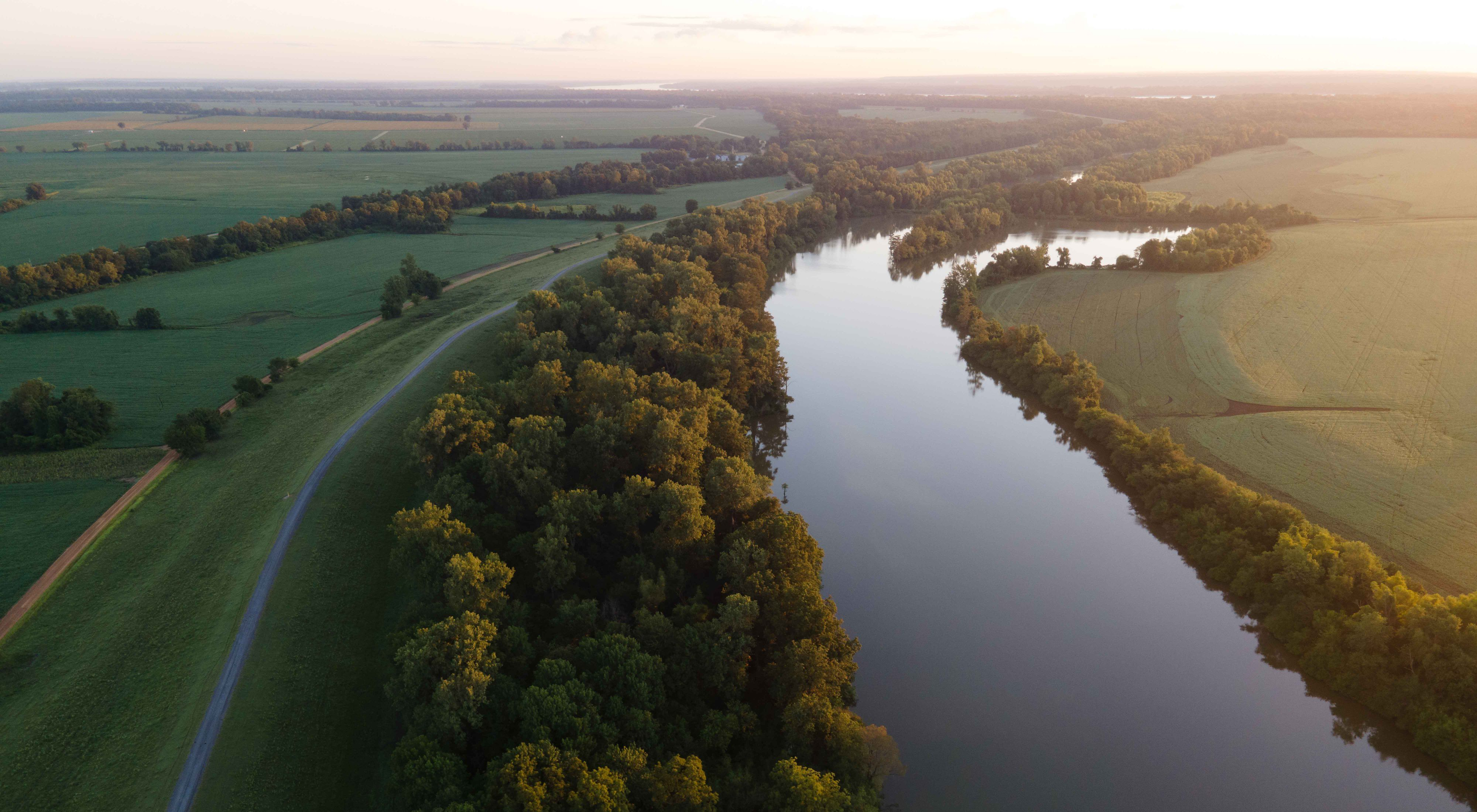 A river winds through forest and farmland.