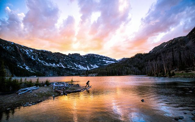 Colorful sunset during a warm summer night at South Meadow Creek Lake in the Tobacco Root Mountains, Montana.
