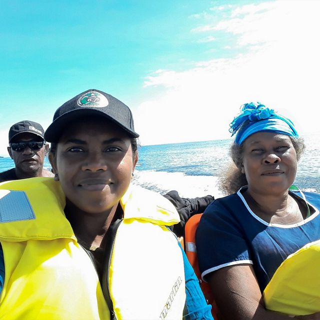 Madlyn Ero, in a hat and life vest, and the Mothers Union Leader on a boat trip in Isabel Province, March 2020.