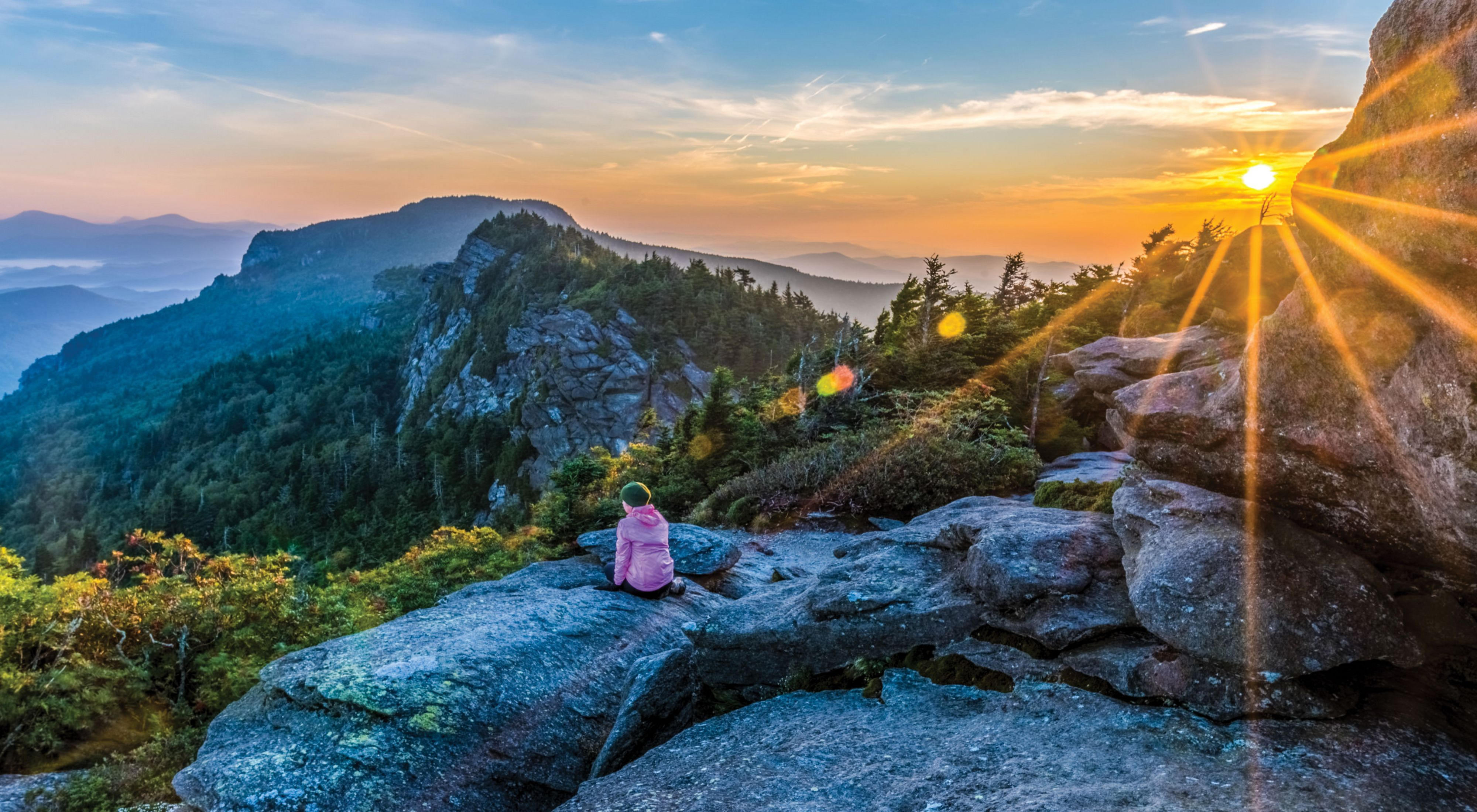 Frances experiences sunrise at Attic Window after camping on Grandfather Mountain ridge.