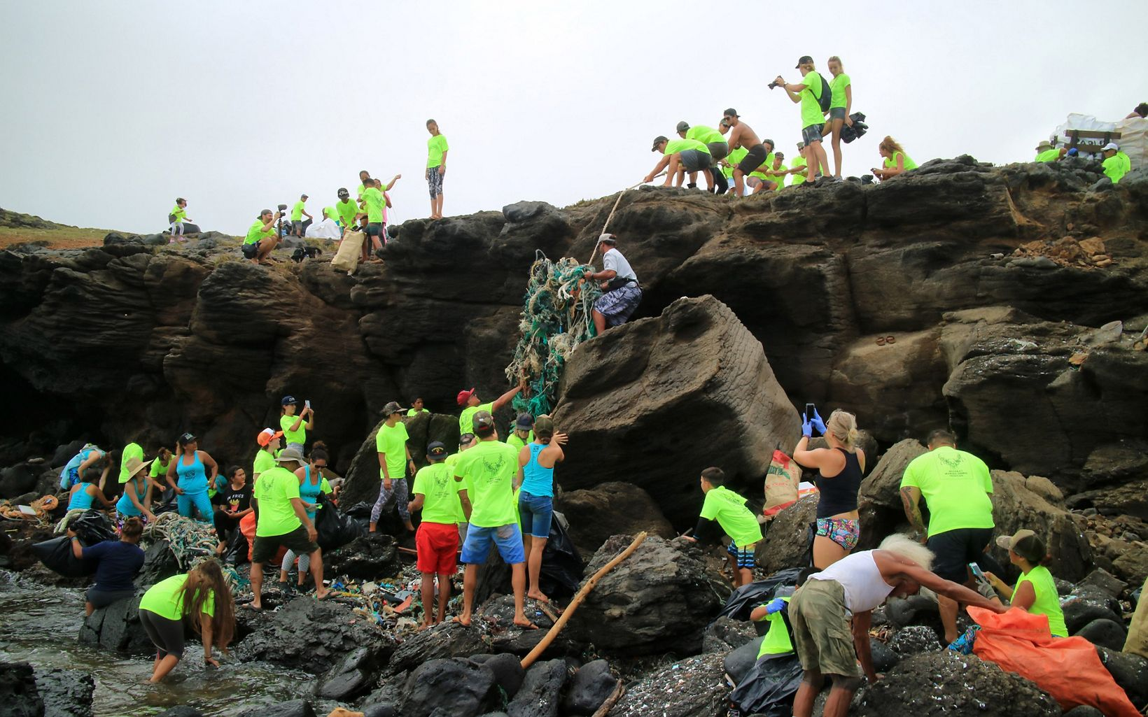 Volunteers removing nets and trash from beach