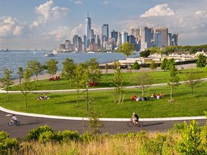 Park-goers enjoy the view at Governors Island in the New York Harbor.