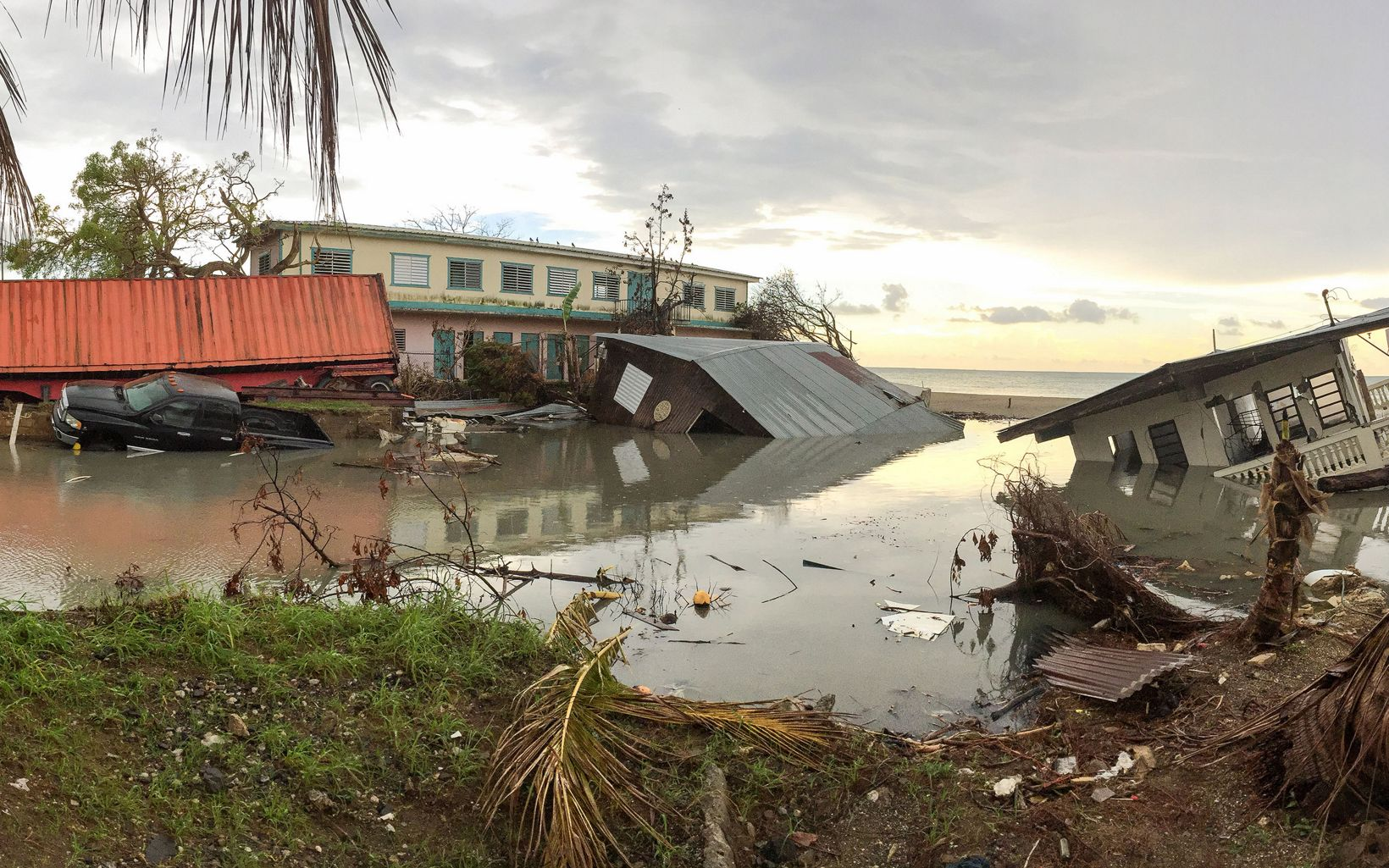 Damaged homes in Puerto Rico sink in elevated waters after Hurricane Maria.
