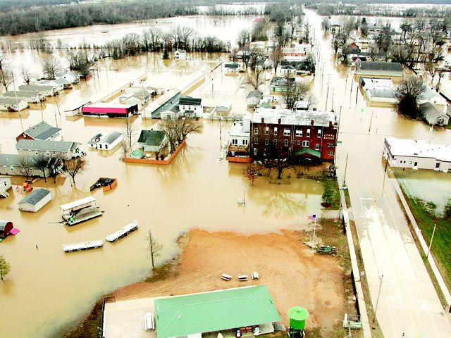 Aerial view of flooded houses and businesses.